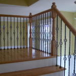 metal basket balusters with traditional profile newel post