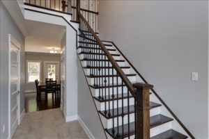Craftsman newel post metal balusters and single left miter stair treads
