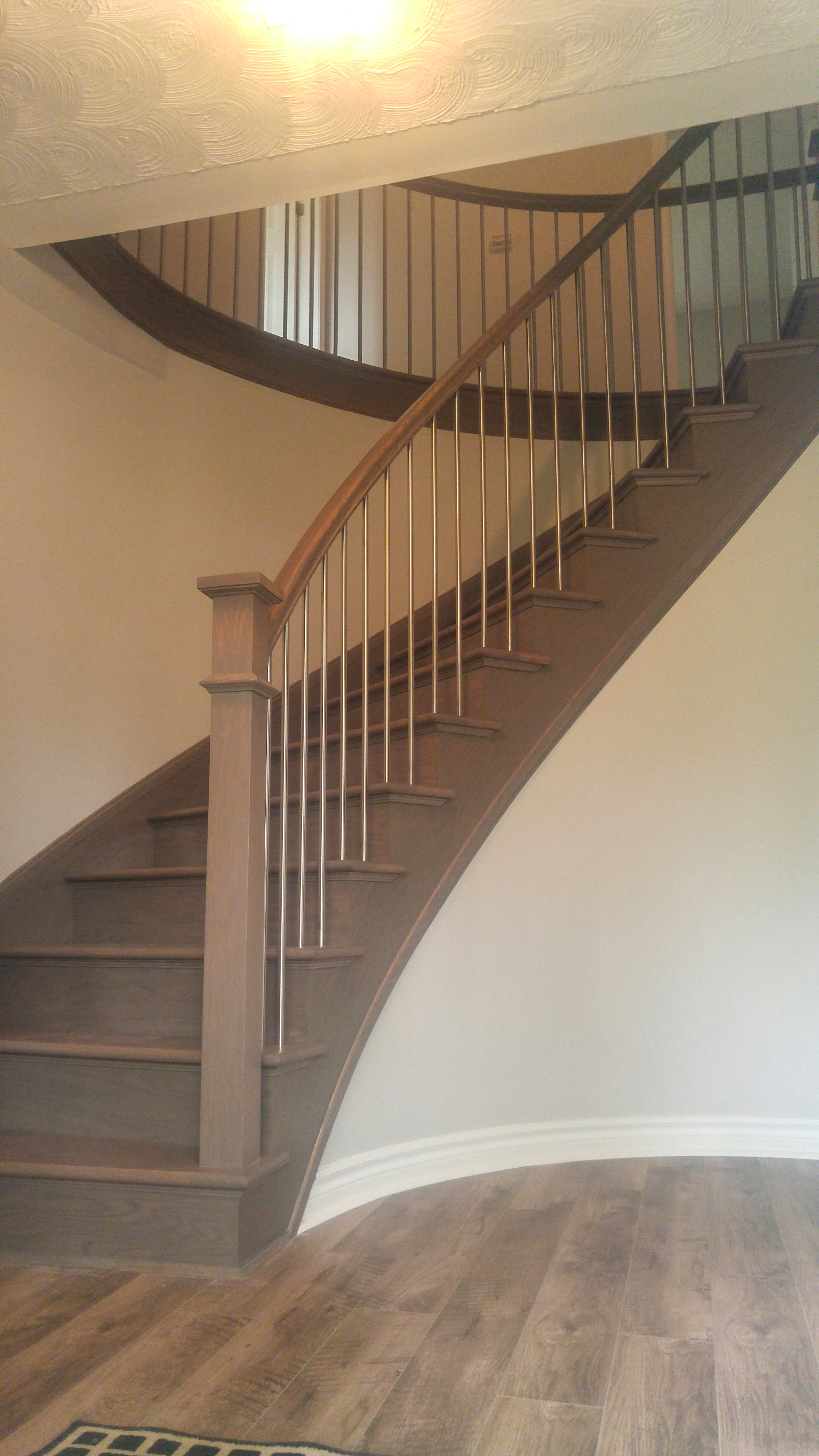 Curved Staircase With Stainless Steel
